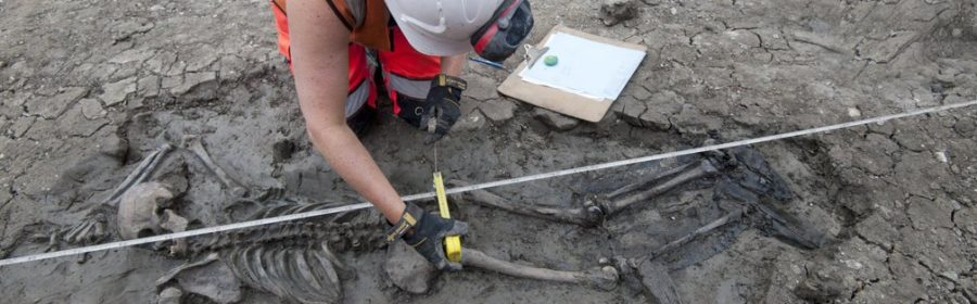 Archaeologists discover medieval skeleton with his boots still on in London