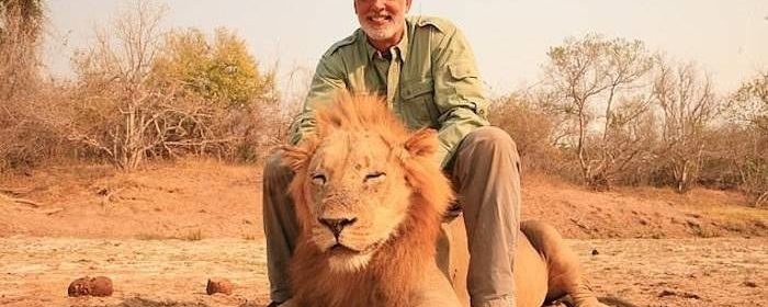 Trophy hunter seen creeping up on sleeping lion and shooting it is identified as Illinois man